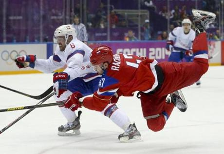 Russian forward Alexander Radulov goes airborne against Norway defenseman Jonas Holos.