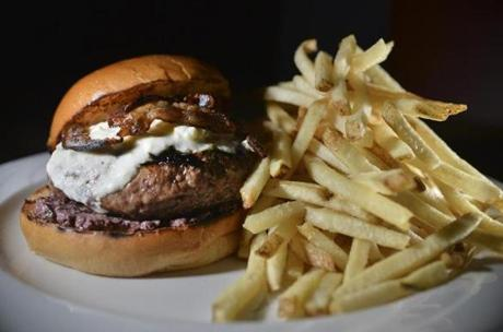 "A burger with bacon at Park in Cambridge. ""We're kind of stretching the boundary of what bacon is,"" executive chef Mark Goldberg says of his lamb bacon."