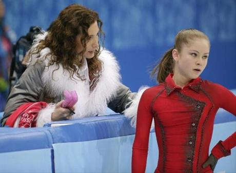 Russia skating prodigy Julia Lipnitskaya gets last-minute instructions from Eteri Tutberidze before her free skate.