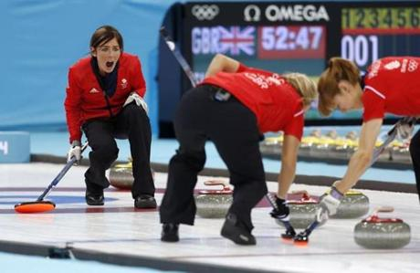 Britain skip Eve Muirhead directs her sweepers during the bronze-medal game in women's curling.