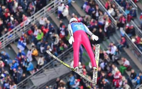 Germany's Eric Frenzel is high above the crowd during the jumping portion of the Nordic combined.