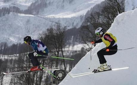 Australia's Scott Kneller Norway's and Thomas Borge Lie are mountain-high in freestyle skiing ski cross.