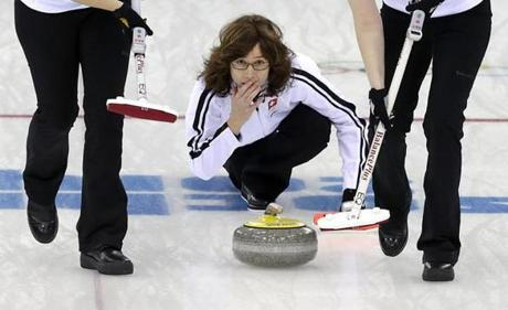 Pensive Switzerland skip Mirjam Ott ponders her angle of approach during the women's curling bronze medal game.