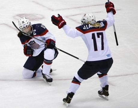 US captain Meghan Duggan (left) is pumped up about her second-period goal, as is teammate Jocelyne Lamoureux.