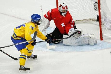 Swiss goalkeeper Florence Schelling robs Erika Grahm of Sweden's during the women's bronze-medal game.