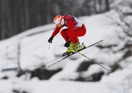 Switzerland's Armin Niederer soars during ski cross.