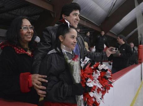 Ortiz with her parents, Gloria and Jorge, prior to a hockey game at which Saugus High seniors were honored.