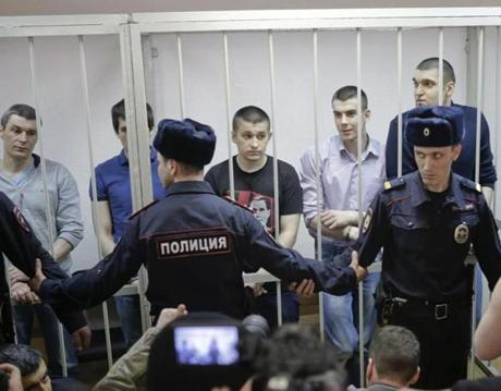 Defendants in a protest case were in a holding cell during a hearing in Moscow on Friday.