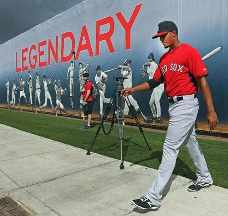 Xander Bogaerts walked in front of a mural of Red Sox legends at JetBlue Park in Fort Myers, Fla.