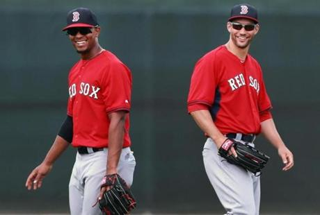 Bogaerts (left) and Grady Sizemore had a laugh during a pop-up drill.