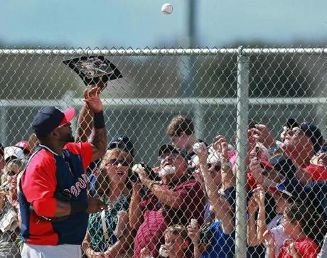 Ortiz tossed a ball that he had autographed over the fence back to a fan.