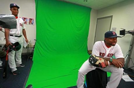 Jackie Bradley Jr. (right) was the subject of the cameras while Xander Bogaerts waited for his turn.