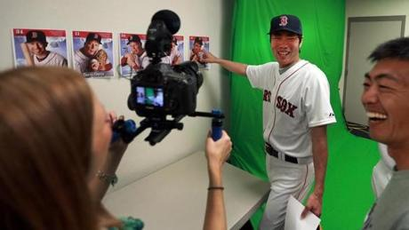 Koji Uehara had some fun as he pointed to a photo of Ted Williams, one of the examples posted on the wall for the poses that the players were going to be asked to do.
