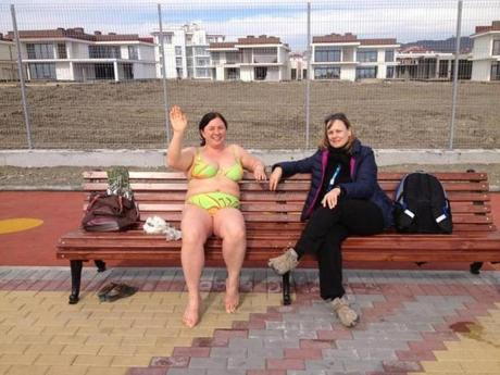 On a day when temperatures climbed to near 70, two women enjoyed the view from a bench on the Black Sea coast.