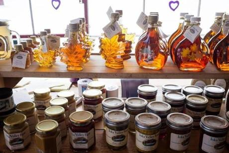 Maple syrup and other maple products on display in the Sugar House.
