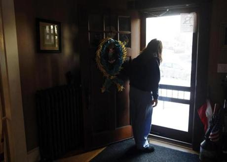 Denise Richard lingered in the doorway as her son Henry headed off to school. The Richards have struggled with the death of Martin and their own injuries over the past year.