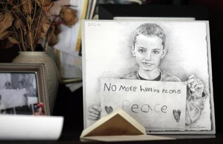 A photo of Martin holding a sign he made for an antiviolence rally became his icon. Artist Dianne Nyitray-Kaericher made a sketch of the image for a calendar and sent it to the Richards.