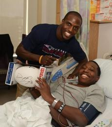 Patriots safety Devin McCourty with a patient at Boston Children's Hospital.