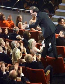 Director and actor Roberto Benigni stood on top of the chairs after winning the award.