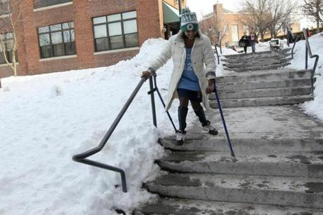After school, wearing her game jersey, and showing her Celtic pride, Joita Diecidue, 14, navigates the stairs at the Pierce school using her crutches as she heads to play an away game.