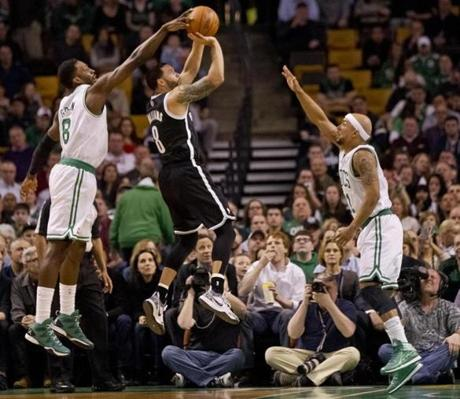 Jeff Green blocked Deron Williams's shot with help from Jerryd Bayless.