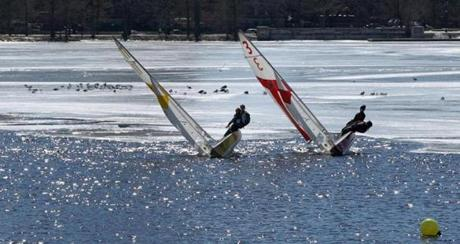 Members of the University of Rhode Island and MIT teams maneuvered near the ice as Tufts hosted the New England Team Race Regatta in front of the MIT Sailing Pavilion in the Charles River.