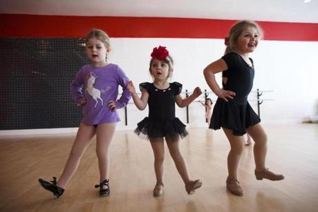 3/08/2014 - Wakefield, MA - Synergy Dance Studio - From let: Lily Allwood, cq, 4, of Billerica; Alessa Arvanites, cq, 3 and Hayllee Arvanites, cq, 4, both of Wakefield, practiced a tap dance routine at Synergy Dance Studio taught by Samantha Cresta, cq, on Saturday, March 8, 2013. She founded the studio after graduating from UMass Lowell in 2012. The 25-year-old entrepreneur has doubled her enrollment since last year. Item: xxsojobs . Story by Emily Sweeney/Globe Staff. Dina Rudick/Globe Staff.
