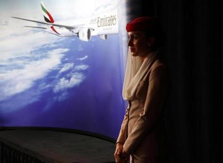 An Emirates flight attendant  attended a press conference to celebrate the  airline's first flight  to land at Logan Airport in Boston.