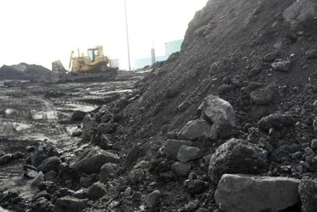 The coal pile at Salem Harbor station is shrinking as the plant's closing nears.
