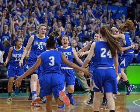 03/10/14: Boston, MA: With the Braintree victory in hand, the starters finished the game on the bench as they watched reserves get their chance to play on the parquet, but when the final horn sounded, the regulars led by Molly Reagan (35) led the celebration charge. Braintree met Lynn English in the girl's Division 1 State Semi Final in basketball, the game was held at the TD Garden. (Jim Davis/Globe Staff) section:sports topic:11Gardenhoops