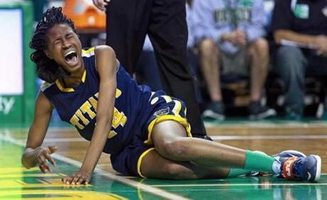 03/10/14: Boston, MA: New Mission's Denia Stewart screams in pain on the floor after she was injured in the second half. She left the game and did not return. New Mission met Greater New Bedford in the girl's Division 4 State Semi Final in basketball, the game was held at the TD Garden. (Jim Davis/Globe Staff) section:sports topic:11Gardenhoops