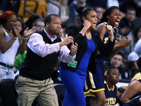 03/10/14: Boston, MA: Left to right, New Mission assistant coach Greg Berry, head coach Brianna Forde, and sophomore center Denia Stewart leap off thre bench together after their team went ahead 55-49 in the second half, causing Greater New Bedford to call a timeout. New Mission met Greater New Bedford in the girl's Division 4 State Semi Final in basketball, the game was held at the TD Garden. (Jim Davis/Globe Staff) section:sports topic:11Gardenhoops