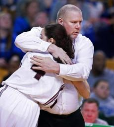 03/10/14: Boston, MA: With the outcome no longer in doubt, defeated Lynn English head coach Fred Hogan pulled his starters, and he has a consolation hug for senior guard Catherine Stinson (4) as she leaves the floor. Braintree met Lynn English in the girl's Division 1 State Semi Final in basketball, the game was held at the TD Garden. (Jim Davis/Globe Staff) section:sports topic:11Gardenhoops