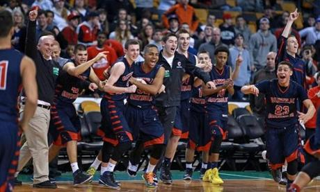 03/10/14: Boston, MA: Head coach Richard Nault (far left) and his Central Catholic players celebrate their victory over Catholic Memorial. Central Catholic met Catholic Memorial in the boy's Division 1 State Semi Final in basketball, the game was held at the TD Garden. (Jim Davis/Globe Staff) section:sports topic:11Gardenhoops