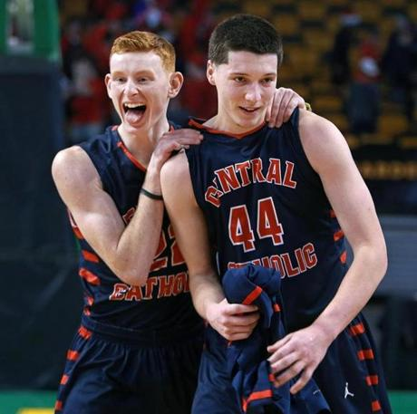 03/10/14: Boston, MA: Central Catholic's Ryan Etter (left) celebrates with teammate, and the star of the game for the Raiders, Nicholas Cambio (right), following their victory. Central Catholic met Catholic Memorial in the boy's Division 1 State Semi Final in basketball, the game was held at the TD Garden. (Jim Davis/Globe Staff) section:sports topic:11Gardenhoops