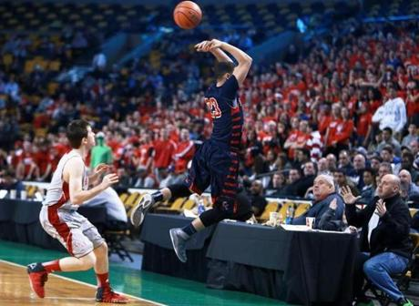 03/10/14: Boston, MA: Central Catholic's Kevin Fernandez makes a great leaping over the head pass to save a first half ball from going out of bounds. Central Catholic met Catholic Memorial in the boy's Division 1 State Semi Final in basketball, the game was held at the TD Garden. (Jim Davis/Globe Staff) section:sports topic:11Gardenhoops