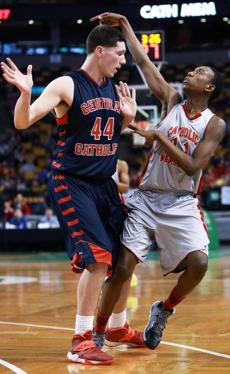 03/10/14: Boston, MA: It looks like ballet, but it is actually Central Catholic's Nicholas Cambio (left) stopping short to make sure he doesn't foul Catholic Memorial's Brandon Twitty (right) as he follows through on a second half shot attempt. Central Catholic met Catholic Memorial in the boy's Division 1 State Semi Final in basketball, the game was held at the TD Garden. (Jim Davis/Globe Staff) section:sports topic:11Gardenhoops