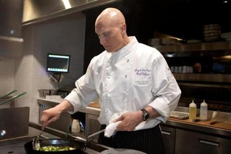 Rich Vellante, executive chef at Legal Sea Foods, prepared a dish in the kitchen of the new Legal Crossing restaurant that's opening in Downtown Crossing.