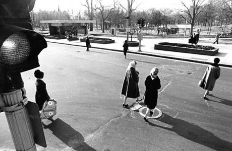 February 7, 1968: Two possibilities to catch one's high heel were the pothole and the manhole cover on Park Street.