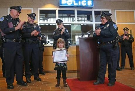 Aryanna Lynch, 3, got a Safety Officer's Award at Weymouth police station for her heroic actions on Feb. 10 when she called for help for her mom who was having a seizure.