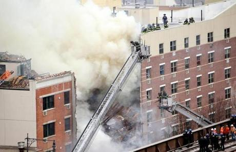 Firefighters battled a fire after a building collapse in New York.