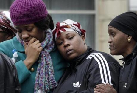 Alecia Thomas (left) was comforted by her friend, Shivon Dollar, after the collapse.