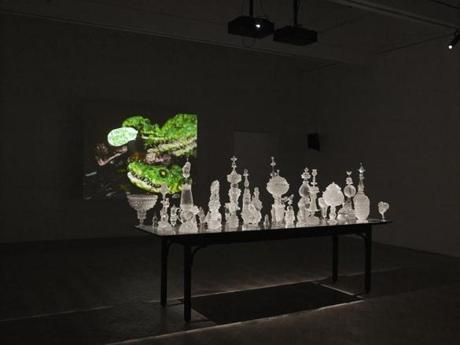 Nathalie Djurberg's films are projected onto walls, with an installation of polyurethane vessels in the middle of the room.