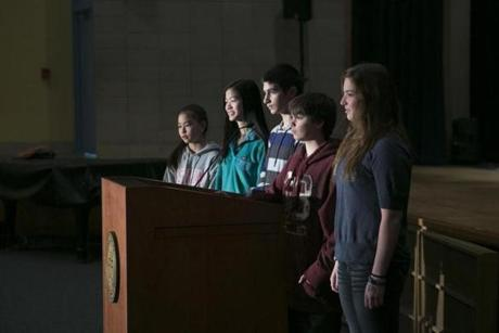 Lincoln School 8th-graders participating in a school project on town government include ( from left) Janie Petraglia, 13, Cal Hamandi, 13, Anna Shorb,14, Luke Belge, 14, and Zoe Belge, 14. The students will attend Town Meeting Saturday to push for a new school bike rack.