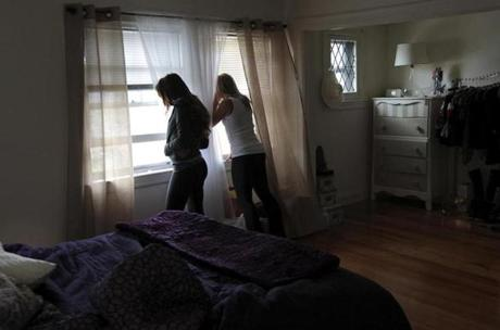 Watertown residents peer through windows during the tense April 19 lockdown.