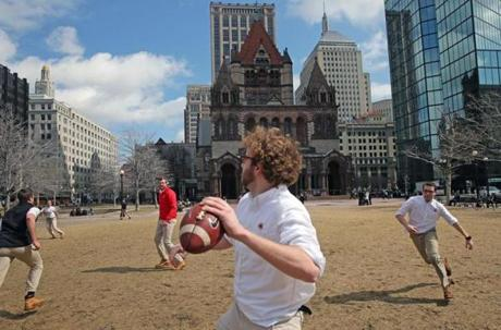 BOSTON, MA - 3/20/2014: IN SHIRT SLEEVES...The quarterback, Eric Howell (cq) during a FOOTBALL LUNCH BREAK at Copley Square for these CITY YEAR members. Glimspes of spring extravaganza since today was the first day of SPRING..... (David L Ryan/Globe Staff Photo) SECTION: METRO TOPIC 21spring(4)