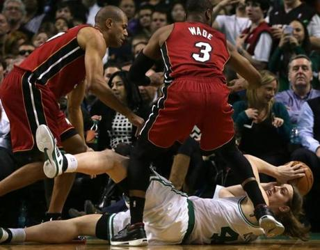 Boston, MA - 03/19/14 - (2nd half) Boston Celtics center Kelly Olynyk (41) dove for a loose ball but lost possession when he fell out of bounds for a turnover early in the fourth quarter. Celtics NBA basketball. The Celtics play the Miami Heat at TD Garden. - (Barry Chin/Globe Staff), Section: Sports, Reporter: Baxter Holmes, Topic: 20Celtics-Heat, LOID: 7.3.1437947373.