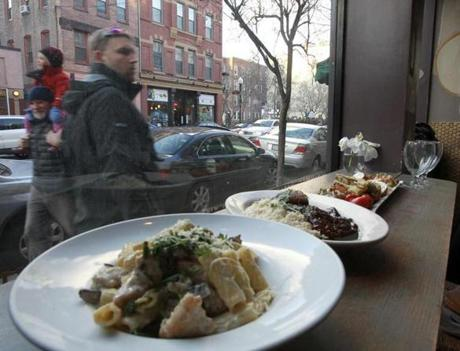 At Pomodoro, diners can watch the North End life pass by from a counter seat while dining on carbonara and veal.