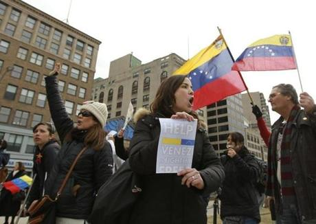 Boston, MA 032214 Anti-Venezuela's president Maduro regime protester, Maria Montero (cq) of Boston, was among 30 or so people protesting across from another group of about 50 people in support of the Venezuelan president at a rally the Boston Common on March 23, 2014. (Essdras M Suarez/ Globe Staff)/ MET