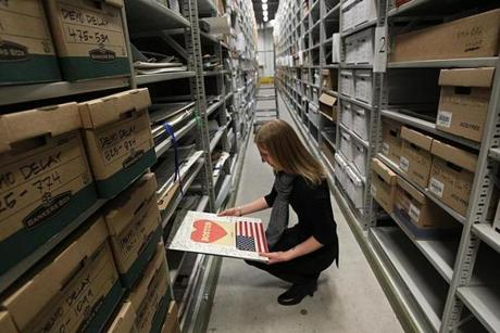 Archivist Marta Crilly among the memorial items being stored in the City Archives, which is keeping many paper artifacts.